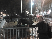 "Wall Street monument, ""the bull"" behind police barricades"